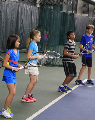 Kids tennis camp in progress on indoor court at Lake Bluff tennis club
